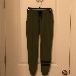63fc9c145e dark green sweatpants with two matte black stripes